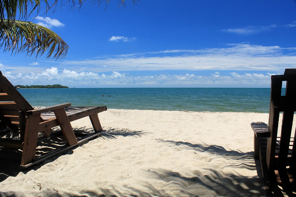 how to buy property in placencia belize